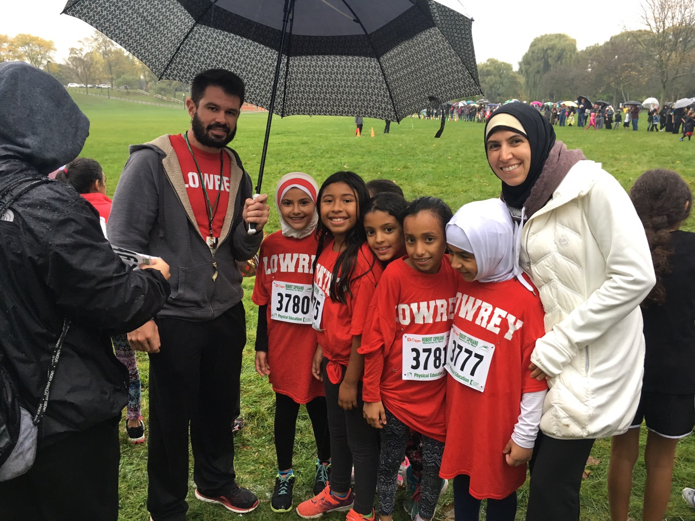 Teacher and Assistant principal standing with students at Cipriano Run