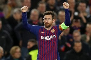 image of Messi wearing a jersey and holding his arms up as if he were cheering