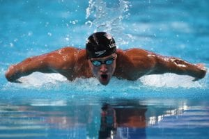 Lochte swimming in the water with a swimming cap and goggles