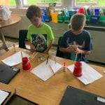 students use materials to build wind turbines