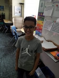 Ahmed Alawahdi beaming with pride, for being the student of the month for December.