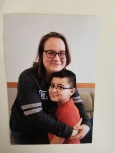 Ms. Rangel Loving hugging her student of the month, Hussien Elchami.