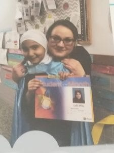 Ms. Rangel is lovingly holding her student of the month, Laila Elhaj.