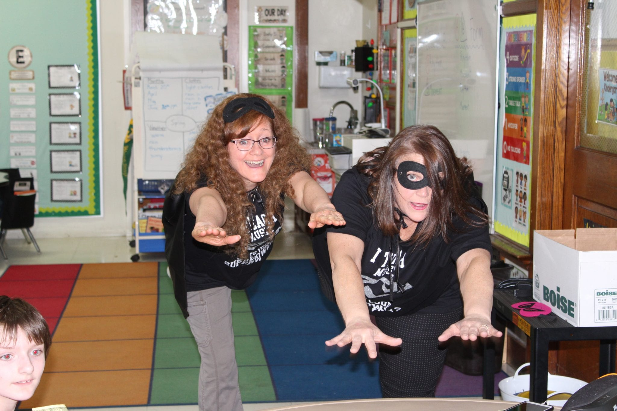 Mrs. Meyers and Mrs. Reed are getting ready to fly like Super Heros.