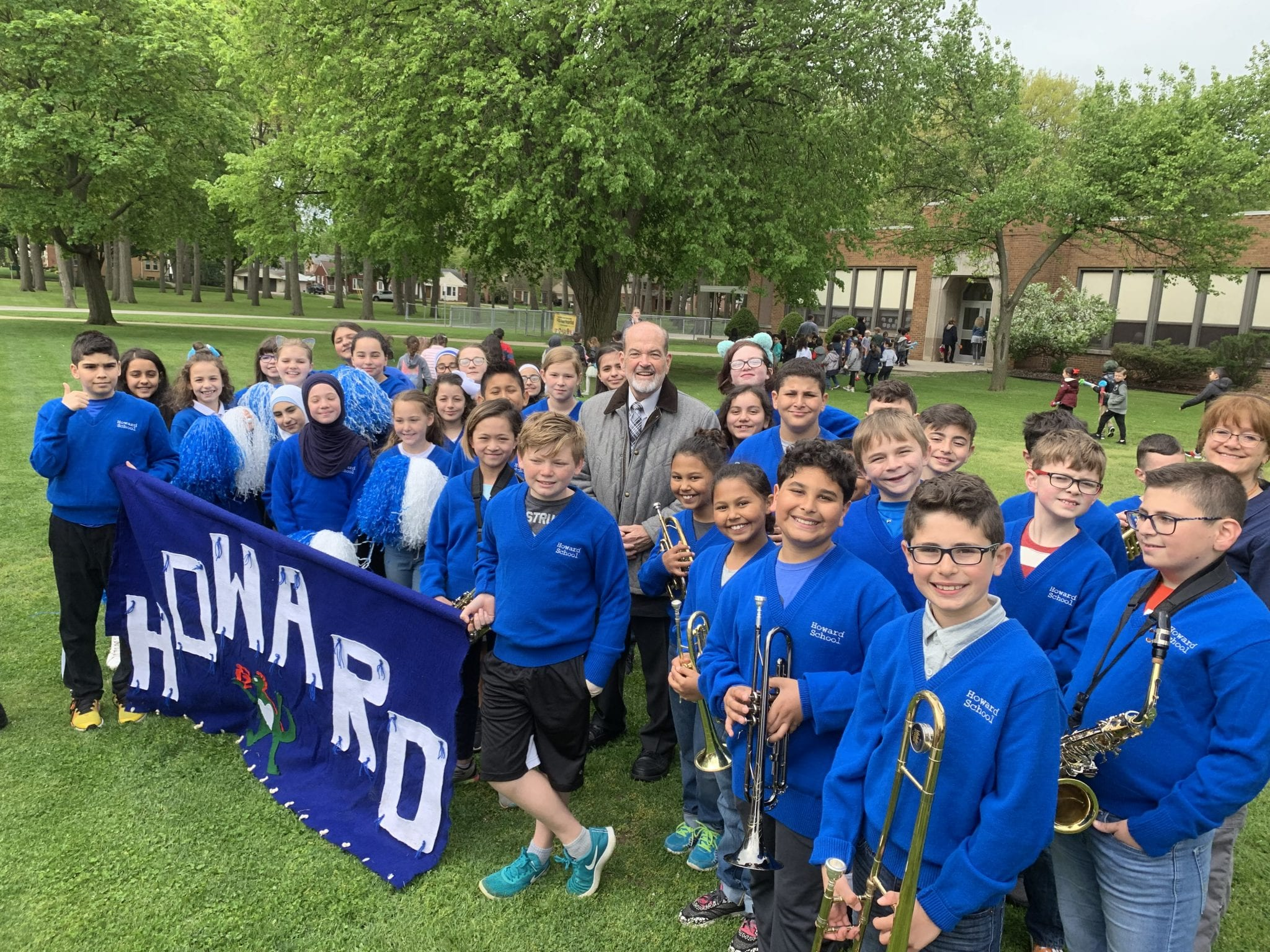 Howard Band and Poms pose with Mayor O'Reilly