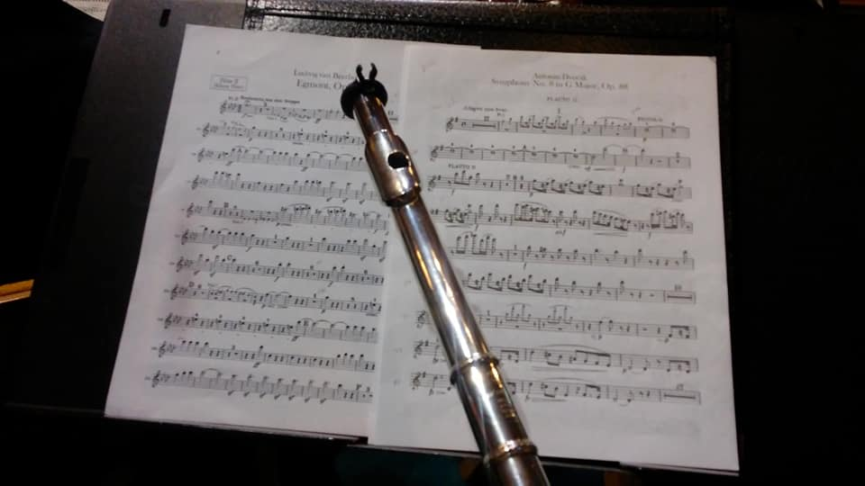 Mrs. Reed's flute is poised across some of her sheet music for the concert.