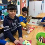 Third graders working on their collage