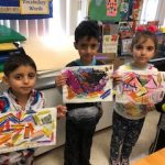 kindergartners are showing their abstract artworks