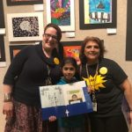 Students at the art show with family and staff.