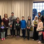 Photo of Miller students and parents with Mrs. Abdullah