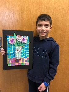 Mohamed holding his 3 dimensional still-Life mosaic vase with flowers