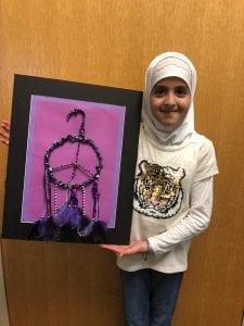 Marwa holding her dream catcher