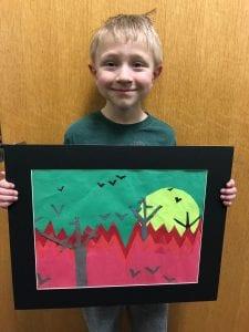 Daniel holding his Value Landscape Collage
