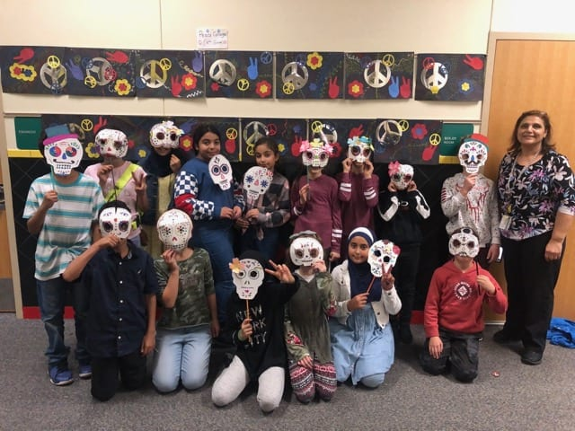 Students wearing their Day of the Dead Mask