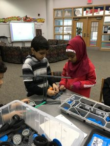 Students building lever.