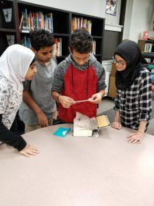 Kids reading a clue