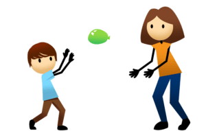 Boy and mom playing balloon volleyball.