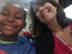 Mrs. Peterson and a kindergarten student enjoying the leadership assembly.