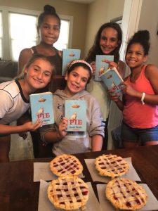 Five girls holding books.