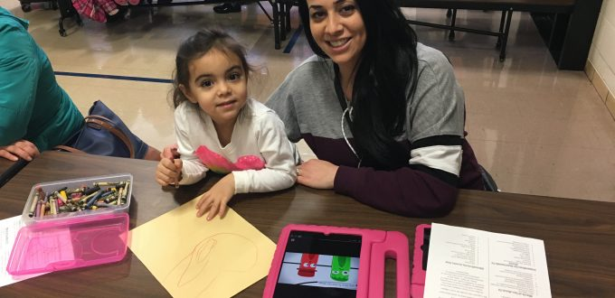 A parent helps her preschooler