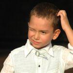 kid scratching head