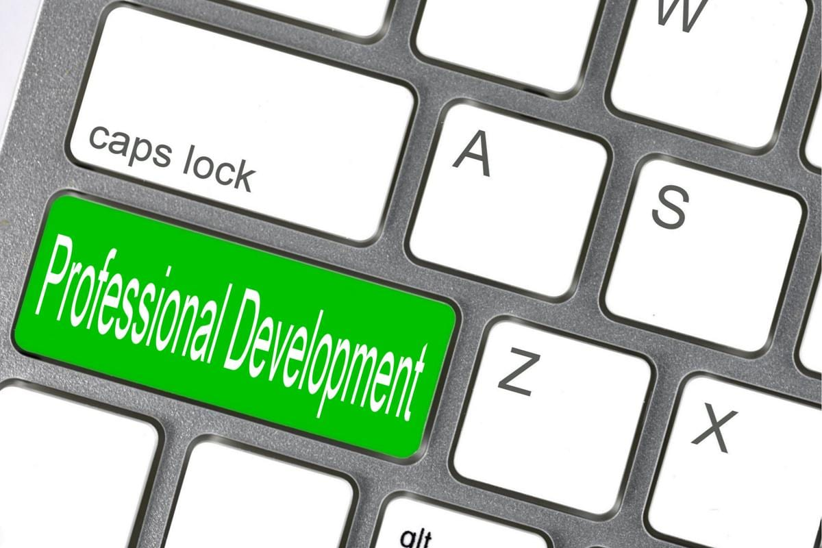 """Keyboard with """"Professional Development"""" written out as a key."""