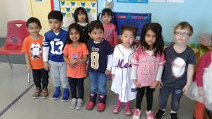 Preschoolers foot for home teams on sports shirt day - The Island Now